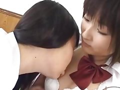 2 Schoolgirls Kissing Spitting Patting On The Bed In The Roo