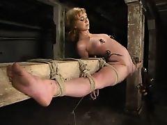 Blonde in overextended bondage
